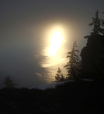 Sunrise glow in the mist at Crater Lake