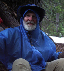 Bill geared for rain--note SNOW in background!